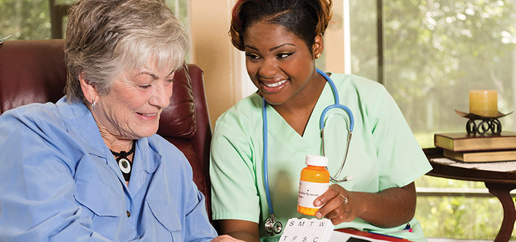 A nurse is helping her patient with meds